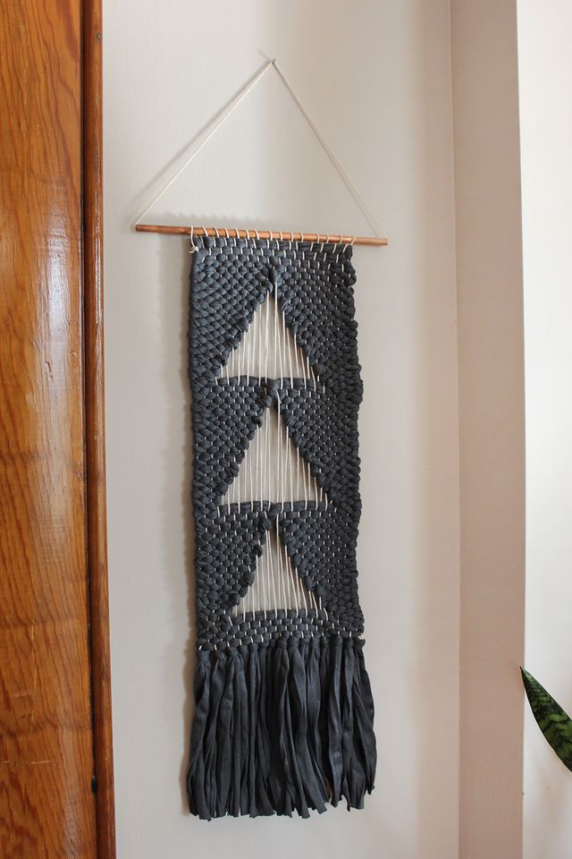 Negative space triangle wall hanging