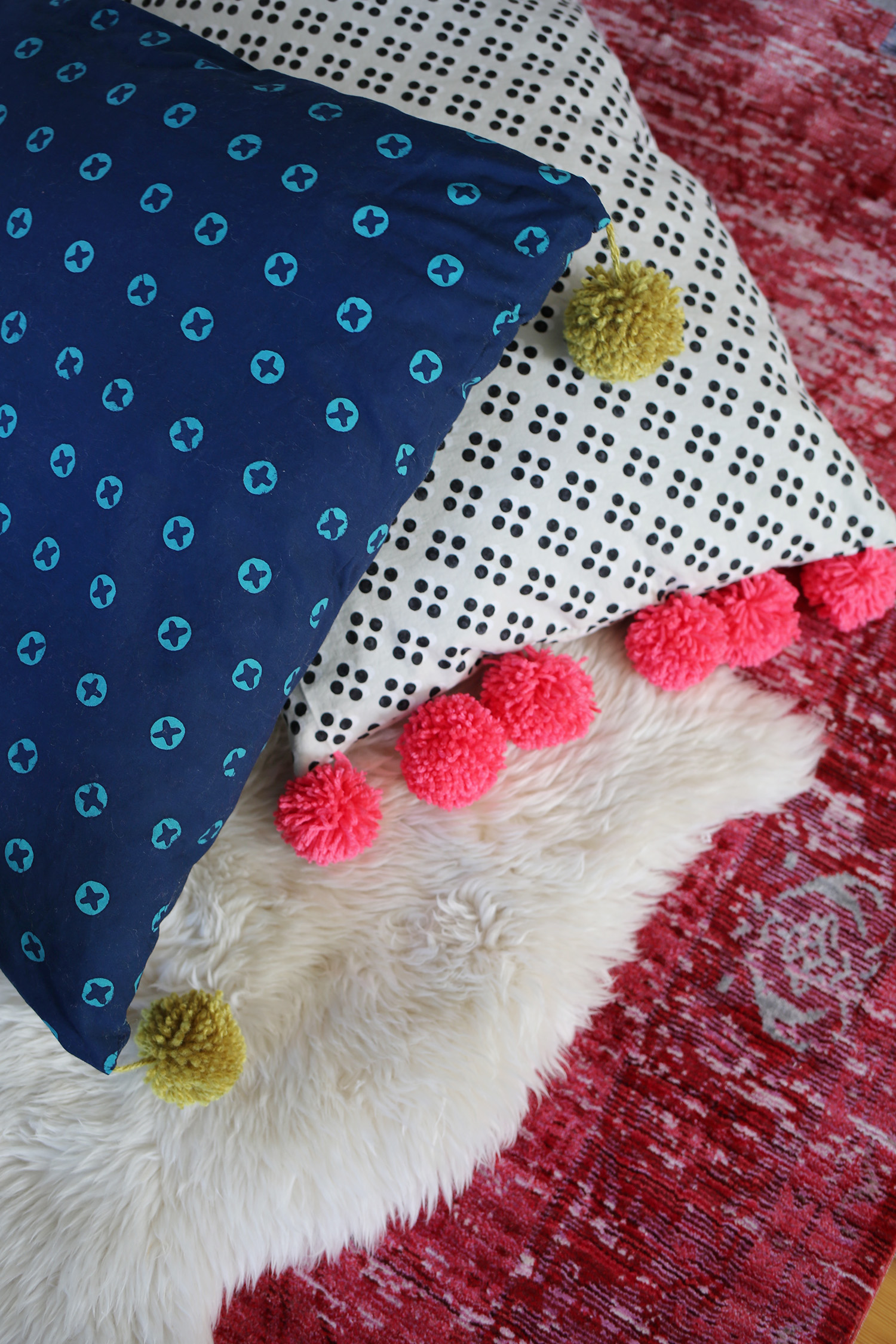 Make your own comfy floor pillows with this easy tutorial over at www.aBeautifulMess.com