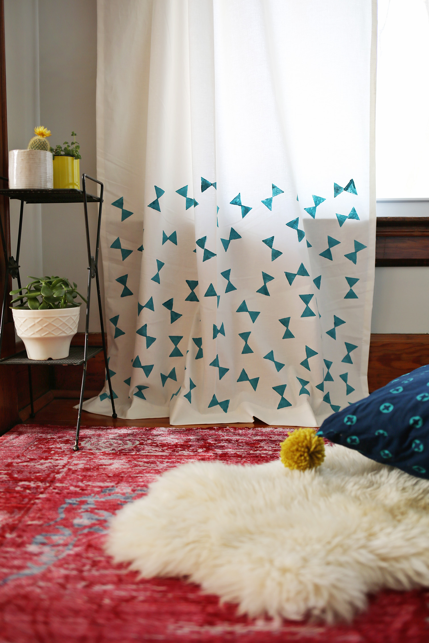 Use a potato stamp to add a sweet bowtie pattern to a simple curtain panel. Get the full details over at www.aBeautifulMess.com