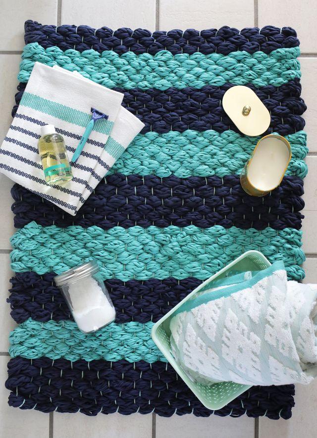 Weave a plush bath mat using fabric yarn. Get the full tutorial for this handmade mat at www.aBeautifulMess.com