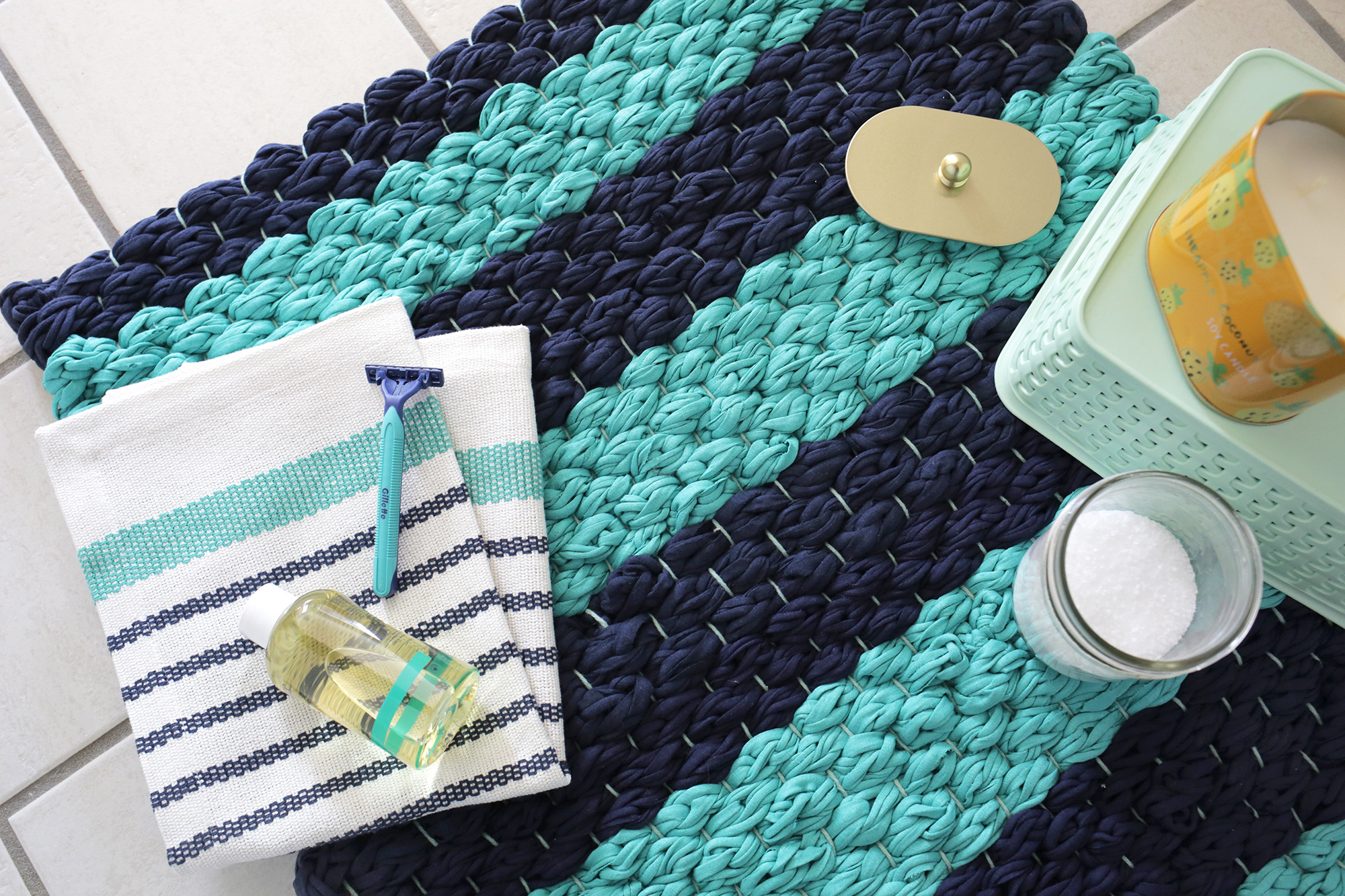 Weave a bath mat from fabric yarn with this easy tutorial at www.aBeautifulMess.com