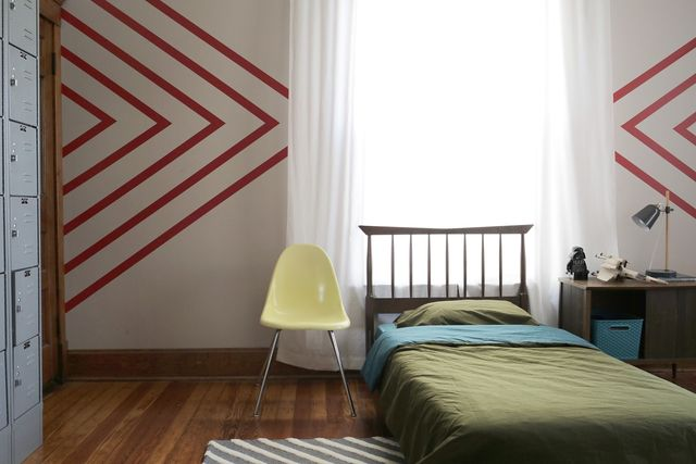 Create a bold design for a teen or pre-teen boy's room with Walls Need Love's Easy Stripe removeable wallpaper. See how I did it on www.SmileandWaveDIY.com