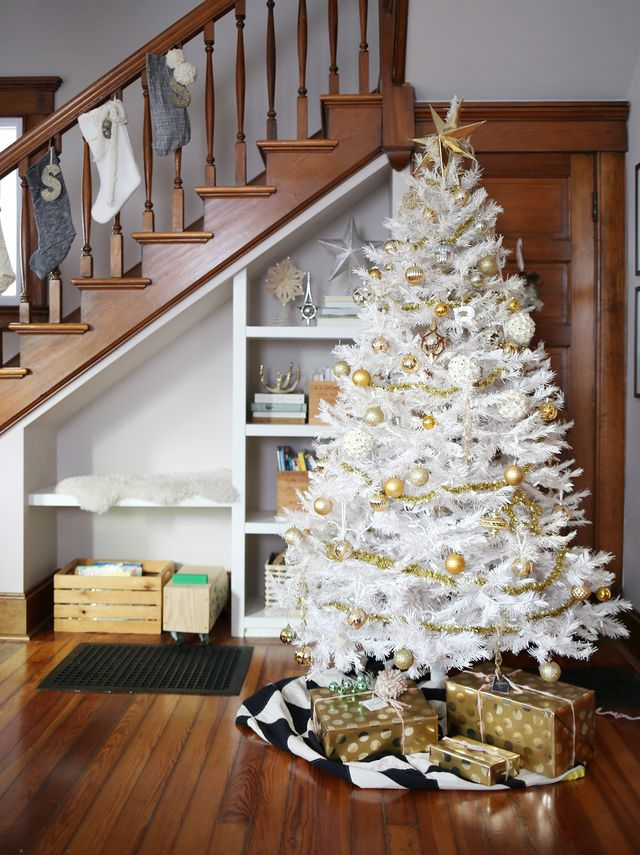 White Christmas tree in remodeled Victorian house. Vintage, handmade, and store bought trimmings in gold