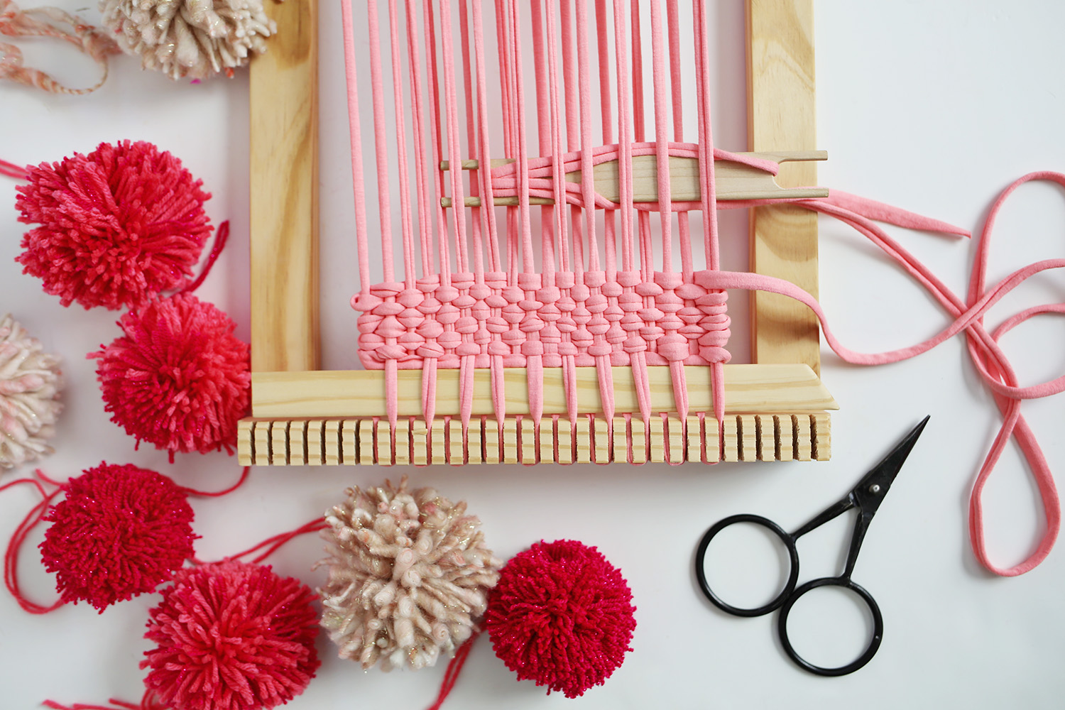 Pom Pom Wall Hanging pom pom woven wall hanging tutorial - smile and wave
