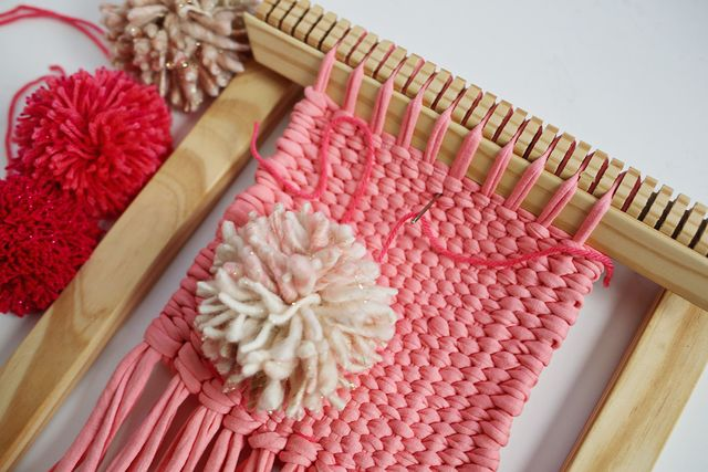Stitch your poms onto your plain weave.