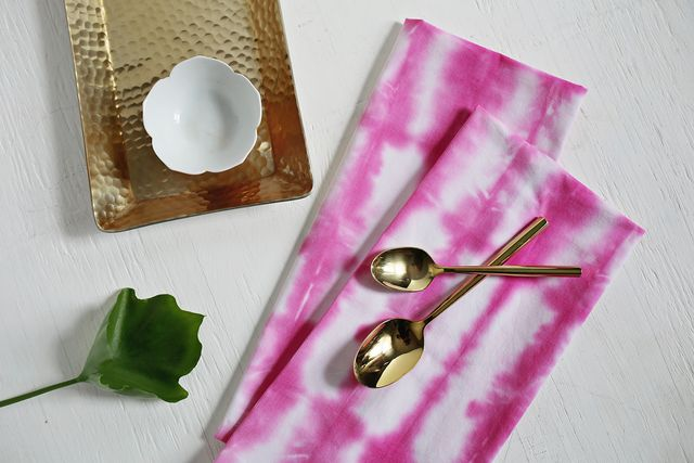 Shibori style cloth napkins using pink tie dye will make any meal feel extra special. Get the step-by-step tutorial on www.aBeautifulMess.com