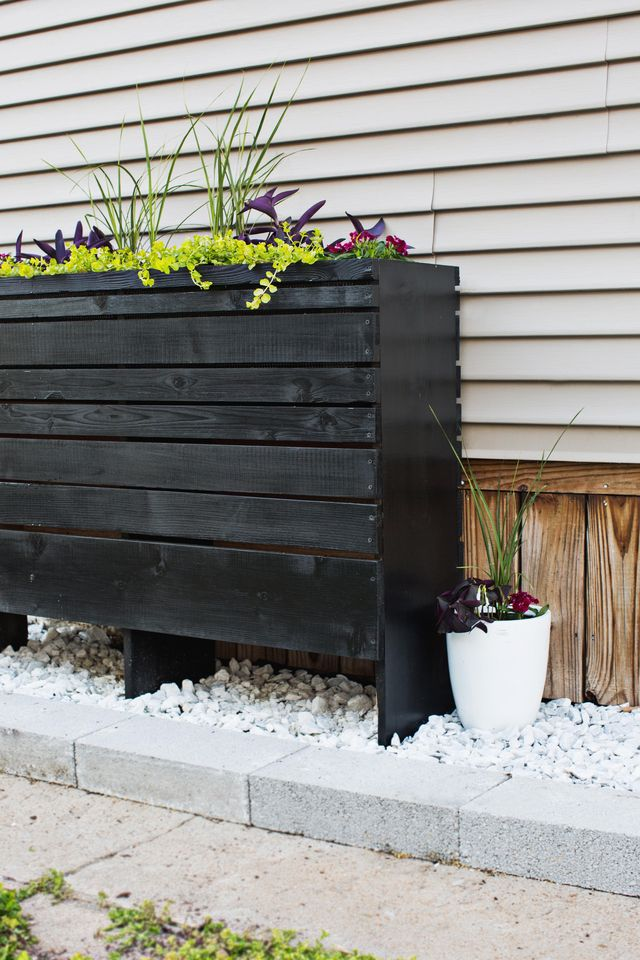 Build your own decorative outdoor cedar planter with this step-by-step tutorial and a full supply list at www.SmileandWaveDIY.com. Instant curb appeal