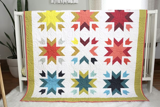 Design your own quilt using hundreds of colors and print options with ShopStitched.com