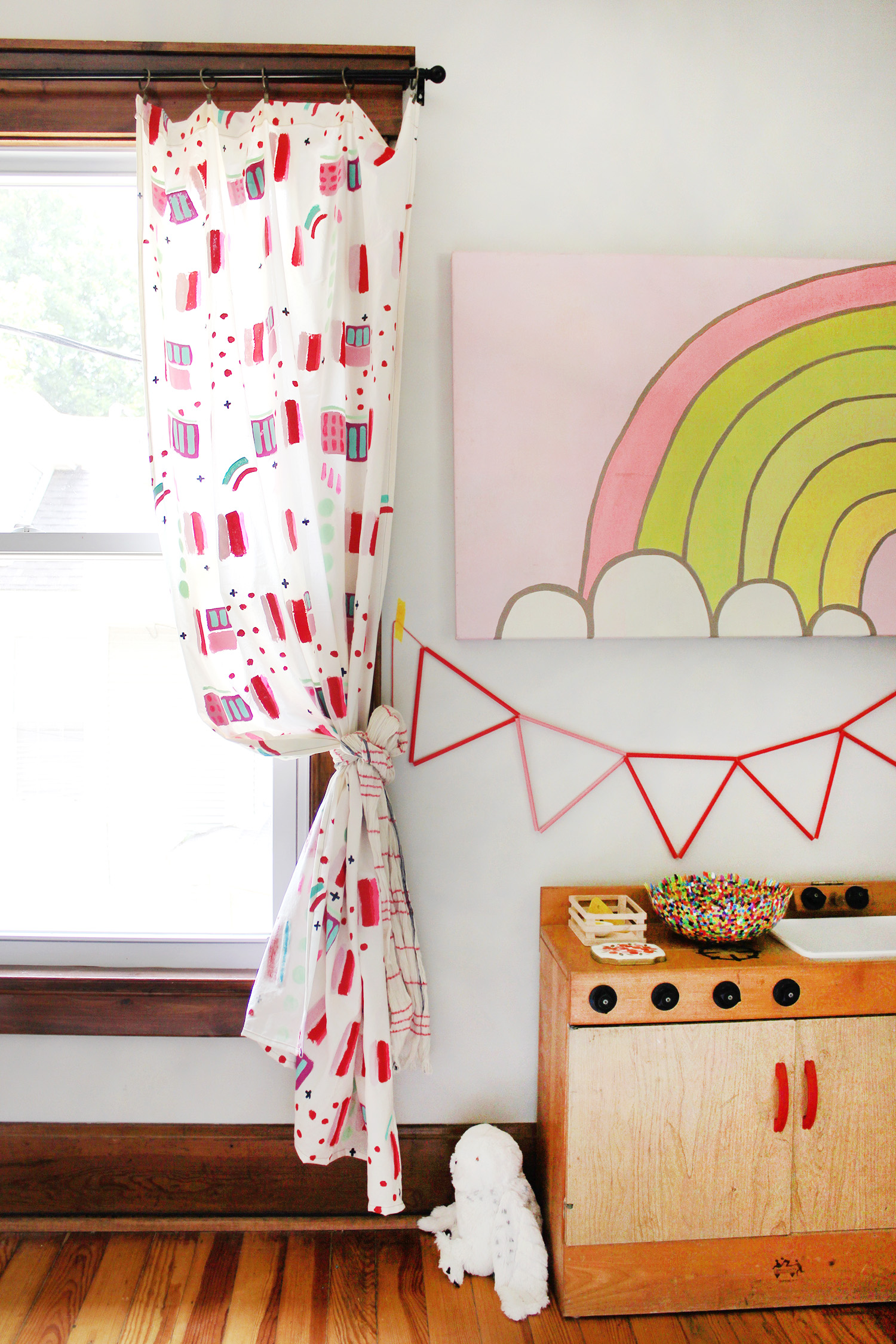 Make an abstract curtaib panel to add some fun to any room. Get the fulltutorial on www.aBeautifulMess.com