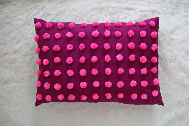 Plum pom pom pillow