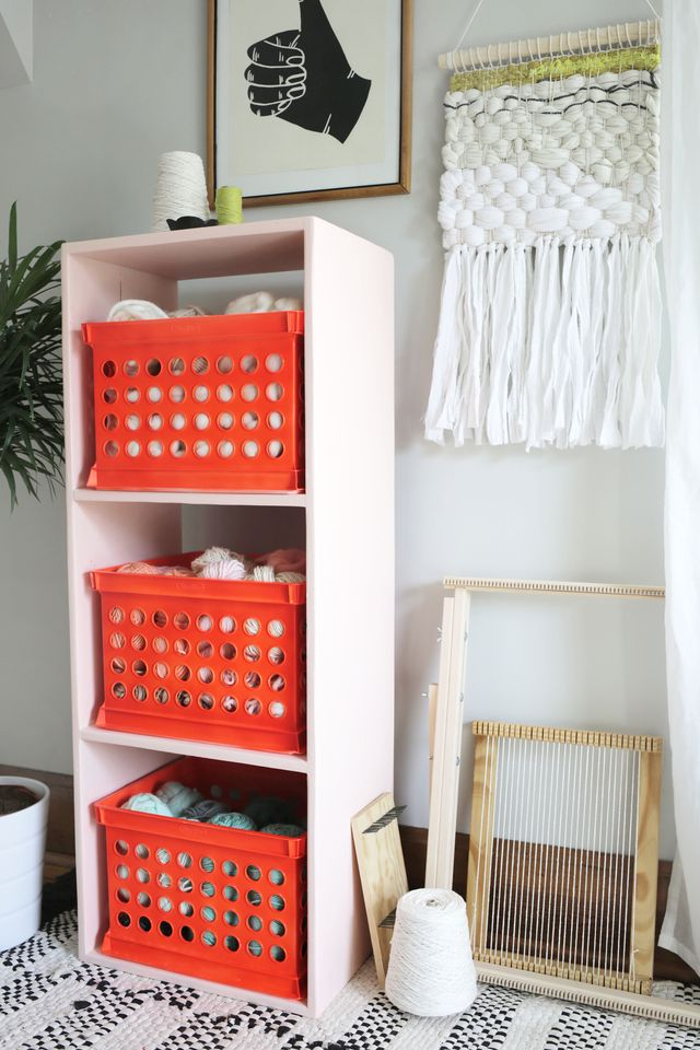 Peach bookshelf with neon orange crush storage on www.SmileandWaveDIY.com